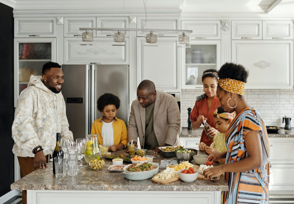 A family having a meal in a kitchen table island